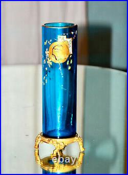 Eugène Rousseau, & BACCARAT. Vase rouleau en cristal bleu émaillé, monté bronze